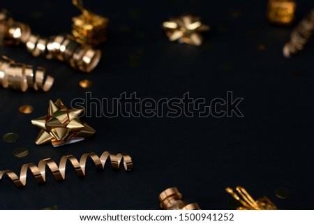 Christmas holiday composition, ornament. Festive creative gold pattern, spruce branches, xmas tree, xmas golden decor holiday ball with gift and ribbon on wooden brown background. Flat lay, top view. #1500941252