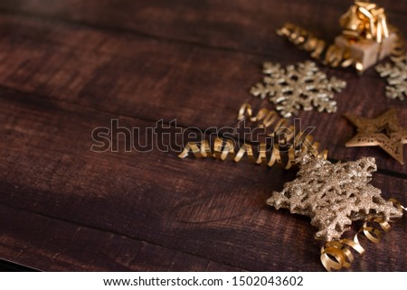 Christmas holiday composition, ornament. Festive creative gold pattern, spruce branches, xmas tree, xmas golden decor holiday ball with gift and ribbon on wooden brown background. Flat lay, top view. #1502043602