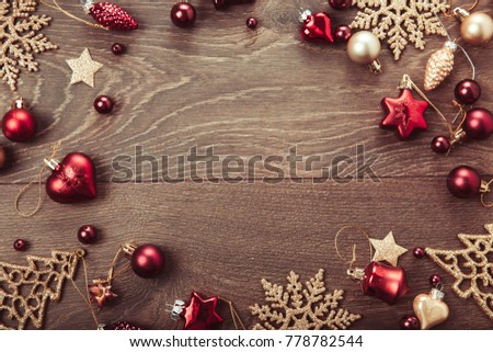 Christmas holiday composition, ornament. Festive creative gold pattern, spruce branches, xmas tree, xmas golden decor holiday ball with gift and ribbon on wooden brown background. Flat lay, top view #778782544