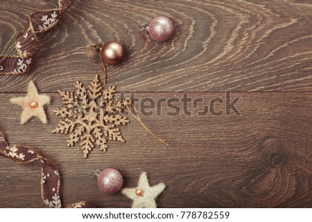 Christmas holiday composition, ornament. Festive creative gold pattern, spruce branches, xmas tree, xmas golden decor holiday ball with gift and ribbon on wooden brown background. Flat lay, top view #778782559