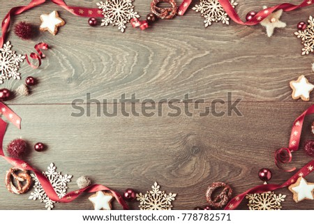 Christmas holiday composition, ornament. Festive creative gold pattern, spruce branches, xmas tree, xmas golden decor holiday ball with gift and ribbon on wooden brown background. Flat lay, top view #778782571