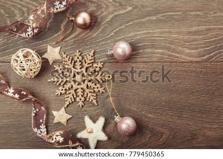 Christmas holiday composition, ornament. Festive creative gold pattern, spruce branches, xmas tree, xmas golden decor holiday ball with gift and ribbon on wooden brown background. Flat lay, top view #779450365