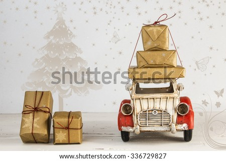 Christmas holiday concept with gift boxes on toy car