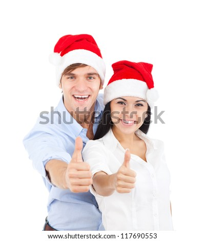 christmas holiday couple couple love excited smiling holding thumb up gesture, beautiful young man and woman smile wear new year red cap hat, isolated over white background