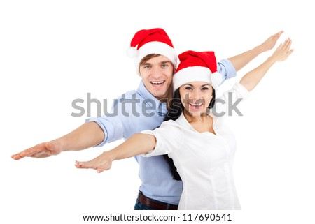 christmas holiday couple couple love smiling with hands outstretched lifted upwards, man and woman being playful smile looking at camera, isolated over white background