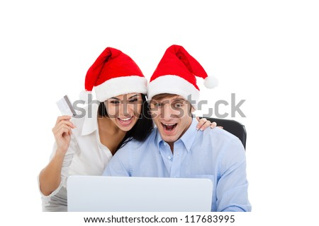 christmas holiday couple shopping on line laptop computer, wear red new year hat cap, excited man and woman hold credit card happy smile, isolated over white background