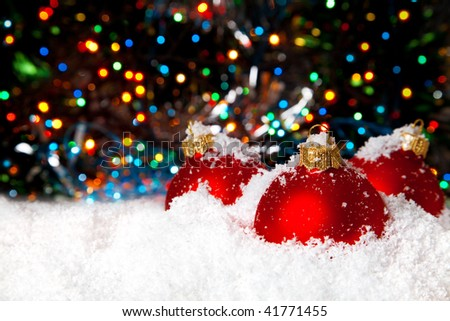 Christmas holiday decoration with white snow festive tinsel and red balls