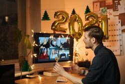 Christmas Holiday Eve in 2021. Parties during quarantine. Office New Year conference party online meeting with friends and family.  Distance Celebration. Video conferencing happy hour.