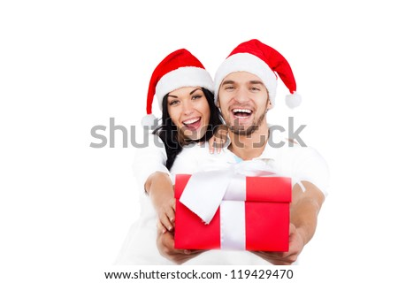 christmas holiday happy couple hold present gift box wear red new year santa hat cap, man and woman love smile looking at camera embracing, isolated over white background