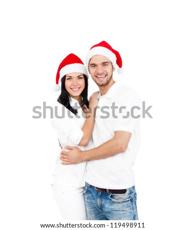 christmas holiday happy couple wear red new year santa hat cap, man and woman love smile looking at camera embracing, isolated over white background