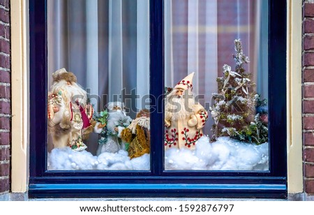 Christmas holiday window decoration view. Merry Christmas window decor. Window decor in Christmas holiday. Christmas window decoration