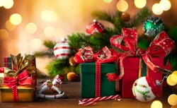 Christmas holidays composition with  gift boxes on wooden background