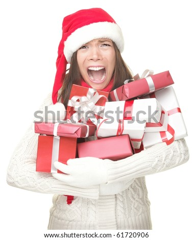 Christmas holidays shopping woman stress. Shopper holding christmas gifts stressed, frustrated and screaming angry. Funny image of Asian / caucasian woman in santa hat. Isolated on white background.