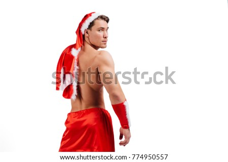 acba44e390e8d Sexy muscular man wearing a Santa Claus hat isolated on white Images ...