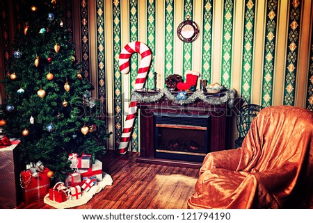 Christmas home decoration with tree, gifts and fireplace.