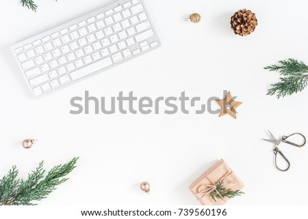 Christmas home office desk with computer, pine branches, christmas gift, golden decorations. Flat lay, top view, copy space