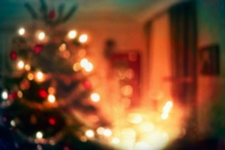 Christmas home room with tree and festive bokeh lighting, blurred holiday background