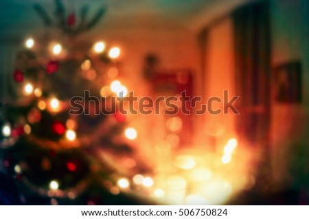 Christmas home room with tree and festive bokeh lighting, blurred holiday background #506750824