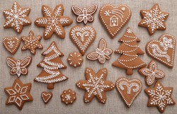 Christmas homemade gingerbread cookies on linen canvas.
