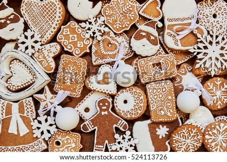 Christmas homemade gingerbread cookies on wooden table. Top view.