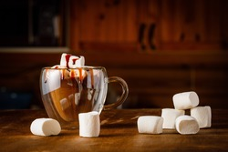 christmas hot chocolate with marshmallows on wooden background