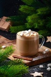 Christmas Hot Drink Cocoa Coffee or Chocolate in Glasses with Marshmallows and Sifting Powdered Sugar on Dark Background