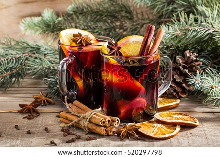 christmas hot mulled wine with cinnamon cardamom and anise on wooden background Сток-фото ©
