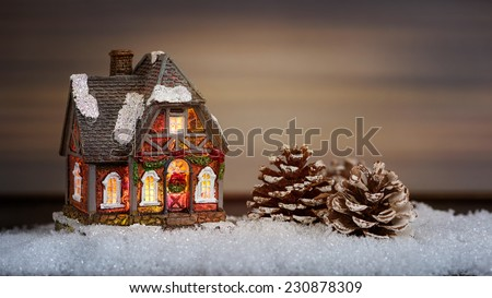 Christmas house and pine cone in the snow #230878309