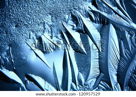 Christmas ice background, macro texture ice cold abstract background in shades of blue