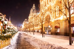 Christmas in Moscow, Russia. Red Square. Christmas and New Year celebration in night Moscow. Night light shining and glowing on red square near GUM. City street decorated for Xmas. Winter cityscape