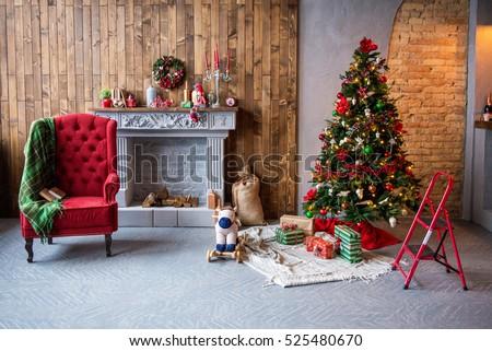 Christmas interior. a comfortable armchair with a rug, gifts, Christmas Tree, fireplace Christmas.The concept of Christmas