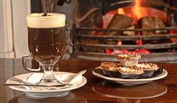 Christmas Irish coffee with Mince Pies and Christmas background