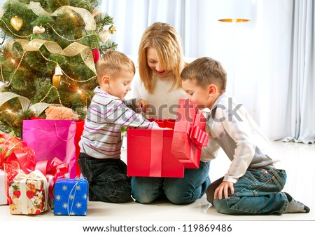 Christmas Kids. Happy Children Opening Gifts. New Year. Christmas Tree