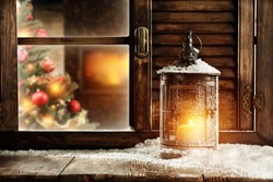 christmas lamp of fire and winter sill background