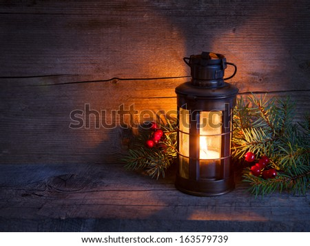 Christmas lantern  in night on old wooden background. focus on the wick candles #163579739