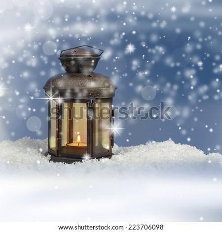 Christmas lantern on snowy background - Shutterstock ID 223706098
