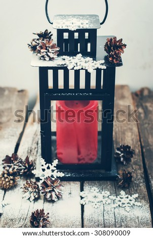 Christmas Lantern with Red Candle and Decorated Snow Flakes on Wooden Table  #308090009