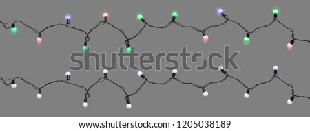 Christmas led light bulbs turned on & off on string isolated on grey background (Clipping included) for Xmas, new year or special events celebration (tree decorative ornament concept)