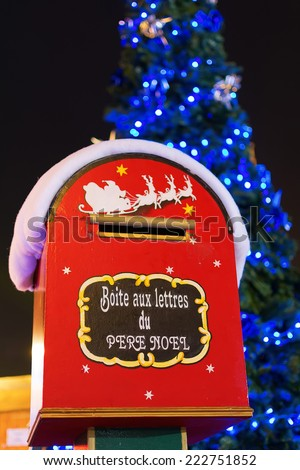 Christmas letter box to Santa with Christmas tree in the background in Paris, France