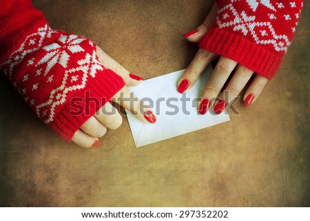 Christmas letter in woman hands