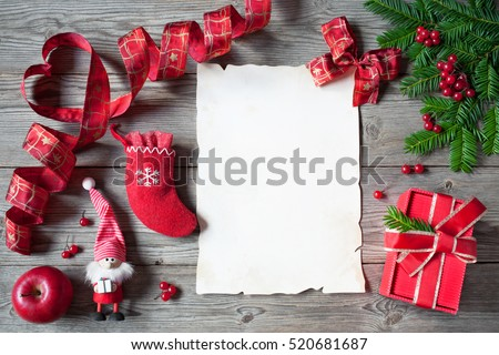 Christmas letter, list, congratulations on a wooden background, gifts in the box, socks and fir branches #520681687