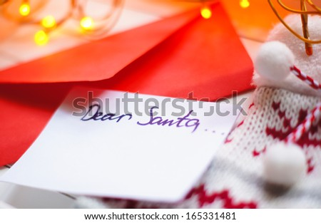 Christmas letter to Santa Claus and different holiday decoration