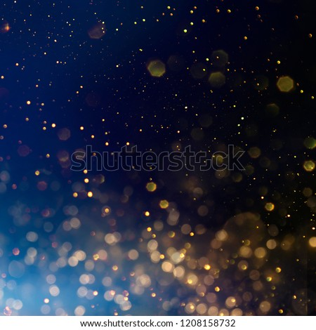 Photo of  Christmas light background.  Holiday glowing backdrop. Defocused Background With Blinking Stars. Blurred Bokeh.