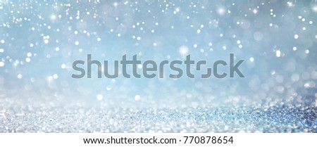 Christmas light background.  Holiday glowing backdrop. Defocused Background With Blinking Stars. Blurred Bokeh. #770878654