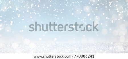 Christmas light background.  Holiday glowing backdrop. Defocused Background With Blinking Stars. Blurred Bokeh. #770886241