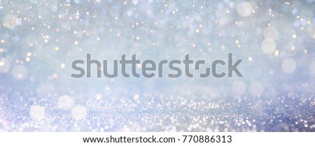 Christmas light background.  Holiday glowing backdrop. Defocused Background With Blinking Stars. Blurred Bokeh. #770886313