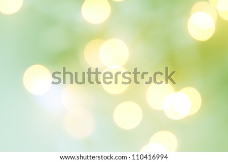 Christmas light bokeh in shades of green and yellow