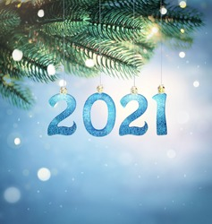 Christmas lights and pine branches and snow. Winter. New year. Secret. Blue festive winter background. 2021.