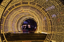 Christmas lights and tunnels at night during the rainy season.