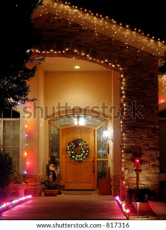 Christmas lights at entry - brick entry with wreath, lights, and snowman.